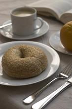 Bagel, Coffee, And Orange For Breakfast