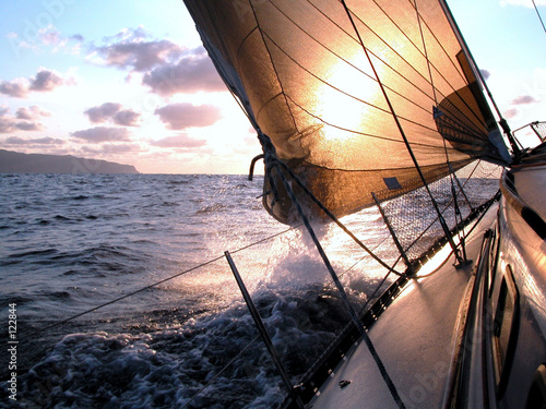Voile sailing to the sunrise