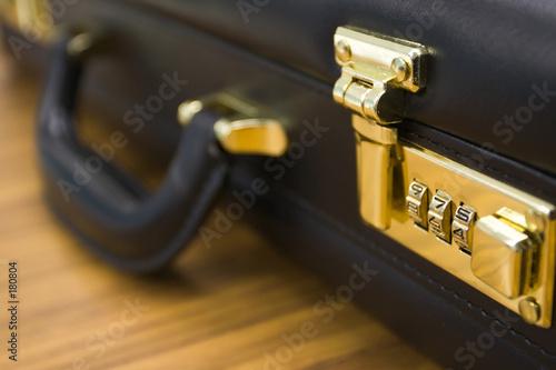 Photo closeup of briefcase: lock in focus