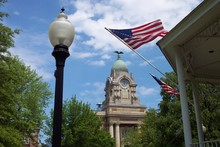 Courthouse With Old Tyme Lamp And Flag