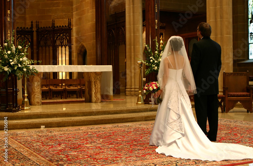 bride and groom at altar (closeup) Canvas Print