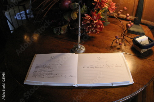 wedding guest book with pen on table Wallpaper Mural