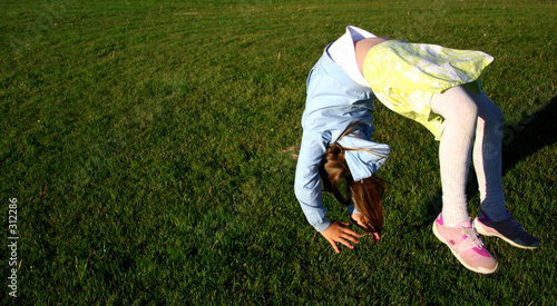 Canvas Print girl doing somersault