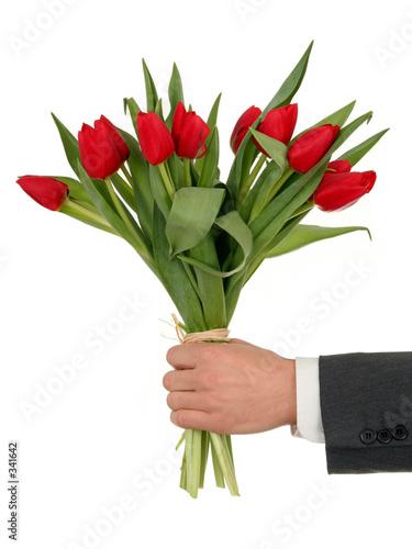 Plakat ręka trzyma kwiaty