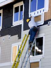 Man Hanging Siding - Construct...