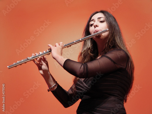 Fotografie, Obraz  beautiful girl playing flute at the concert