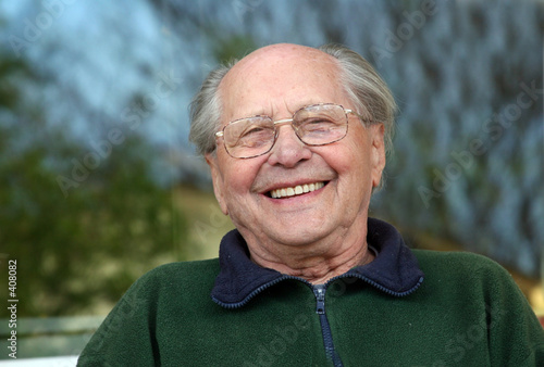 old man laughing on a blurred background