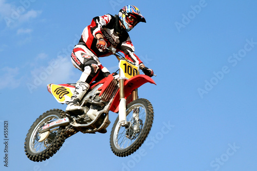 Photo sur Toile Motorise red motocross in the sky