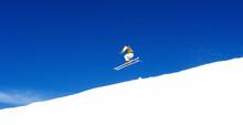 Man Skiing On Slopes Of Ski Resort In Spain