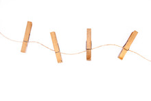 Three Clothespins On Curly Rope