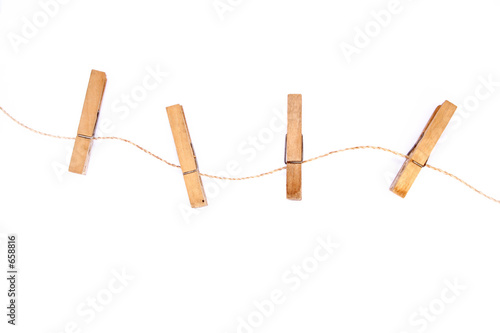 Fotografie, Obraz  three clothespins on curly rope