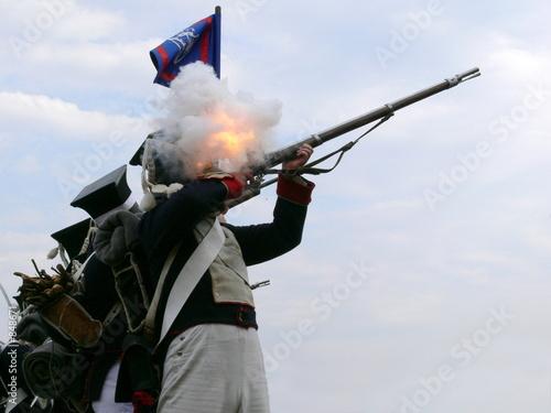 Fototapeta a soldier firing a rifle
