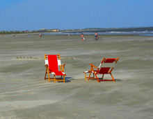 Two Red And White Beach Chairs