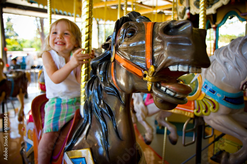 Fotografie, Obraz  girl on a carousel