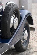 Front Side Of Dark Blue Retro Cadillac