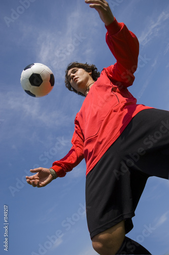 Fotografie, Obraz  soccer football player in red controlling ball