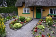 Thatched Roof Cottage And Garden