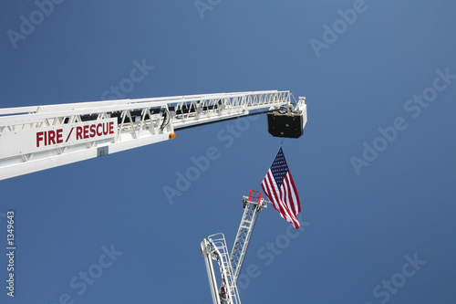 Photo  usa flag and fire truck ladders
