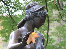 Statue Of An Ancient With Autumn Leaf