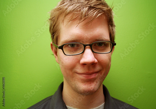 Valokuva  young man with glasses smiling