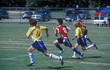 canvas print picture - junior soccer / football - chasing the ball