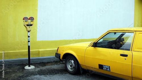 Fototapeta parking meter with yellow car obraz na płótnie