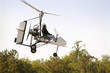 canvas print picture - gyrocopter in flight