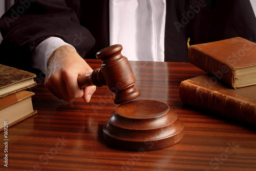 Fotografering  judge hand with gavel
