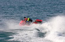 Young Couple Speeding On Board A Large Rescue Jetbike