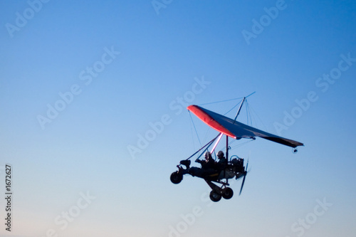 microlight aircraft in silhouette