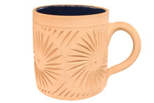 A Patterned Unglazed Cup Isolated On A White Backg