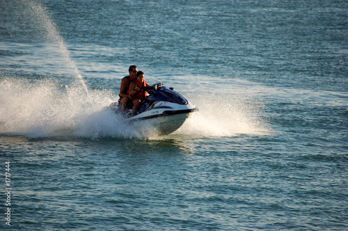 Poster Water Motor sports woman and man on a jetski