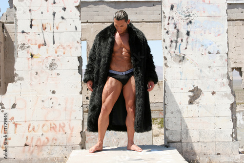 Fotografia, Obraz  muscular man in fur coat