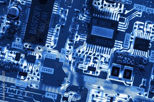 Fotografía  blue glowing circuit board