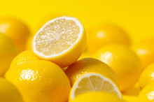 Group Of Lemon On Yellow Backg...