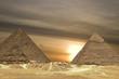 Leinwandbild Motiv pyramids sunset drama