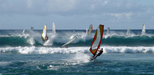 People Windsurfing On High Waves