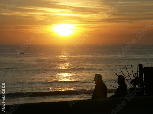 Foto auf AluDibond Pier silhouettes au coucher de soleil