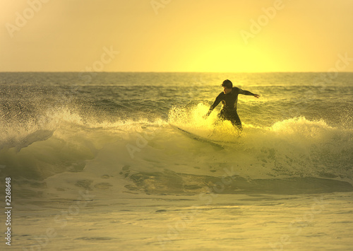 Poster Water Motor sports sunset surfer in the wave