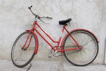 Old Red Bicycle Leaning Agains...