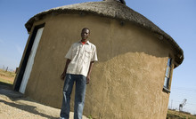 Proud African Outside His Home
