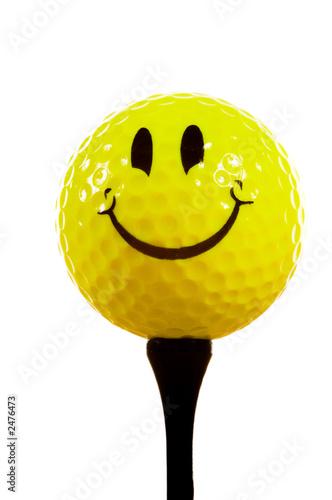 Valokuva  smiley face golf ball on white background