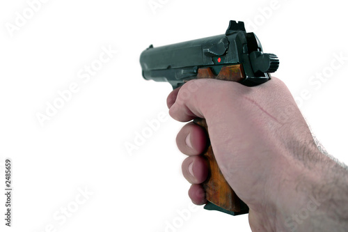 Foto  hand holding a pistol