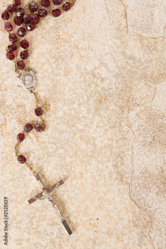 rosary beads on stone with copy space Fototapeta