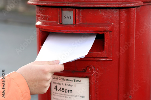 posting letter to red british postbox Canvas Print