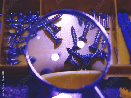 a set of screws under a magnifier #2653841