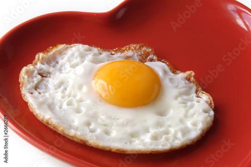 Deurstickers Gebakken Eieren traditional fried egg on heart shape plate