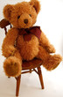 canvas print picture teddy bear sitting on a chair
