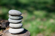 zen stones balanced on log