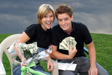 Young Couple With A Bouquet Of Money Flowers Ii